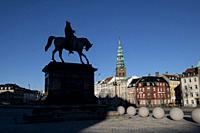 Equestrian statue silhouette of Christian VII, with spire of St Kunsthallen Nikolaj Church, Christiansborg Palace, Copenhagen, Denmark.