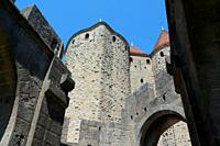Partial view of the towers that compose the Narbonne Gate to the fortified city of Carcassonne. Languedoc - Roussillon, France.