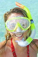 A woman smiling wearing snorkeling gear, Formentera, Baleric Islands, Spain.