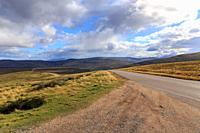 Lonely highway through the Cairngorms national park in Scotland, UK.