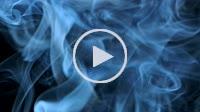 Thin trickle of blue smoke slowly rising graceful twists up on black background. Smoke billow rising swirl to top on black background. Closeup
