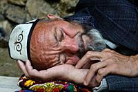 Kyrgyz man sleeping ( Kyrgyzstan).