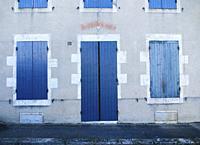 house front with blue shutters, Laparade, Lot-et-Garonne Department, Nouvelle Aquitaine, France.