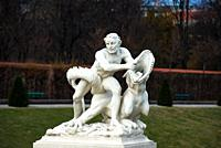 Sculpture of a man wrestling a crocodile in Belvedere Palace formal gardens, Vienna, Austria.
