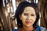 woman with traditional face mask, in Morondava, Madagascar, Africa.