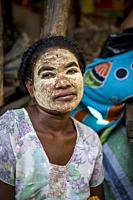 woman with traditional face mask,saleswoman, market, Morondava, Madagascar.