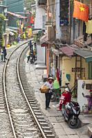 View of Hanoi train street between Le Duan and Kham Thin Street in Hanoi old quarter, Hanoi, Vietnam, Asia.