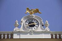 Schonbrunn Palace or Schloss Schenbrunn. Clock at the top of the building.
