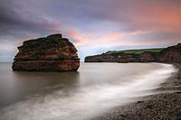 A sandstone sea stack at Ladram Bay near Sidmouth in South East Devon, captured at sunset in mid September.
