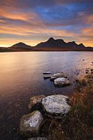 Rocks on the waters edge at Loch Hakel, near Tongue in the far north of Scotland. The image was captured at sunrise in early November, with Ben Loyal ...