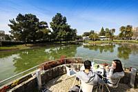 Restaurant terrace Casa do Lago. Lake and gardens, University of Lisbon, Portugal. Europe.
