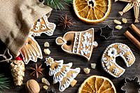 Christmas decoration - a linen bag with decorated gingerbread cookies, straw ornaments, star anise, walnuts, cinnamon, frankincense resin and dried or...
