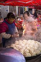 Dumpling, Friday market in Shaxi, a historic market town, Yunnan, China.