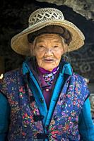 Elderly Woman at White Dragon Pool shrine near Shaxi, Yunnan, China.