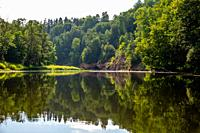 Landscape with cliff near the river Gauja and forest in the background. The Gauja is the longest river in Latvia, which is located only in the territo...