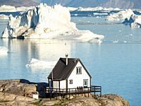 The town Uummannaq in the north of West Greenland, located on an island in the Uummannaq Fjord System, in background the Nuussuaq (Nugssuaq) Peninsula...