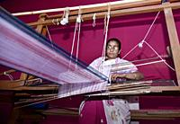 Guwahati, Assam, india. 8 March 2019. Women weaving Assamese Traditional gamosa agead of Rongali Bihu in Assam.