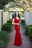 Portrait of professional flutist [Alla Sorokoletova] in elegant red dress - Boca Raton, Florida, USA.