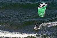 Female Kitesurfer off the coast of Lauderdale-by-the-Sea, Florida, USA.
