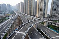 Chongqing, China, Asia - New high-rise housing development and elevated motorways in the outskirts of the metropolis. The megacity is situated at the ...