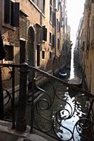 narrow canal with bridge, Venice, Italy.