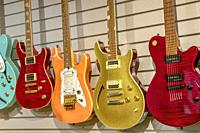 Five electric guitars.