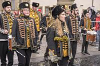 STUTTGART, GERMANY - MARCH 5: female players in marching band with musicians dressed up as old style militars in parade under light rain. Shot at Carn...
