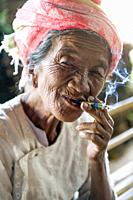 Myanmar (ex Birmanie). Inle lake. Old woman smoking the cheroot the Burmese cigar.