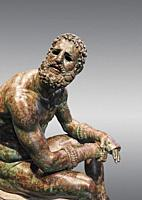 Rare original Greek bronze statue of an Athlete after a boxing match, a 1st cent BC. The athlete, seated on a boulder, is resting after a boxing match...