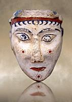 A unique plaster head of a women, possibly a goddess of sphinx, one of the few examples of Mycenaean plater art. The severe expression is excentualted...