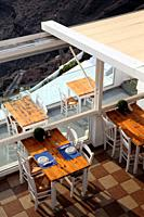 Table of a restaurant seen from above, Oia, Santorin, Greece, Europe.