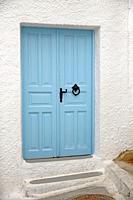 Blue entrance door to a house in Pyrgos, Santorin, Greece, Europe.