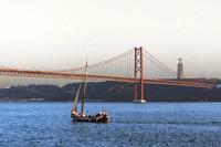 Bridge of 25 April and Almada Cristo Rei statue Belem district, Lisbon, Portugal.