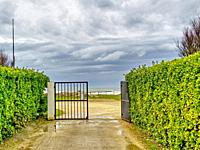 entrance to beach from Chassiron lighthouse, Ile dâ. . Oleron, Charante-Maritime Department, Nouvelle Aquitaine, France.