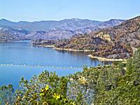 Whiskeytown Lake following the 2018 Carr fire in Shasta and Trinity Counties, California. Burn areas surround the lake.