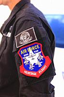 Close-up of the badge on a flight crewmembers arm show they are a member of the USAF Heritage Flight.