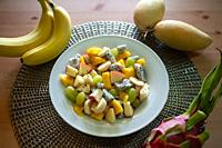 Singapore, Republic of Singapore, Asia - Freshly prepared fruit salad with mango, banana, green grapes, apple and dragon fruit.