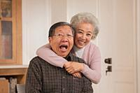 Portrait of loving old couple, Chinese ethnicity