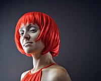 Tricky beauty. Funny female portrait withcrazy makeup end hair style.