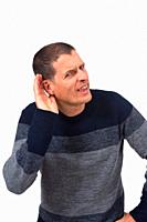 man putting a hand on her ear because she can not hear on white background.