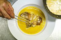 Pumpkin cream with scallops and mushrooms.