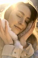 emotive woman with snow in hands cooling down her head