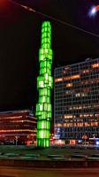 Glass Obelisk illuminated green at night, Sergels Torg, Stockholm, Sweden, Scandinavia. The 1974 obelisk is by Edvin Ohrstrom. The square is named aft...