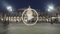 Brescia, Italy, March 16, 2019: Timelapse in the night at Piazza della Loggia in Brescia, view of the clock tower and the people walking
