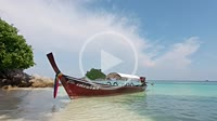 Traditional longtail boat in Thailand near the beach of beautiful Ko Lipe island