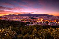 View of eastern Athens and Hymettus mountain from Lycabettus hill at dawn. .