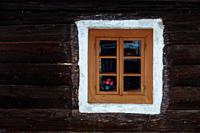Window of a traditional house in Turcianske Jaseno village, northern Slovakia.