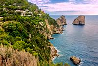 Sea view by Capri island, Italy. The rocks are famous as Faraglioni rock. Locals say that they have seen sirens on this rock and often hear their whis...