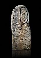Late European Neolithic prehistoric Menhir standing stone with carvings on its face side. The representation of a stylalised male figure starts at the...