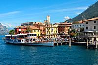 Passenger ship in the Harbor of Malcesine on Lake Garda - Italy.